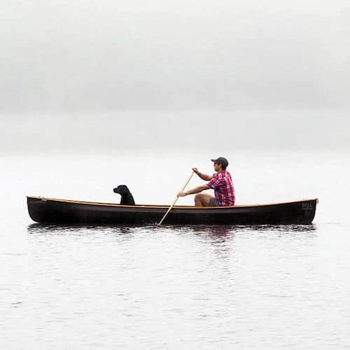 solo paddle a canoe