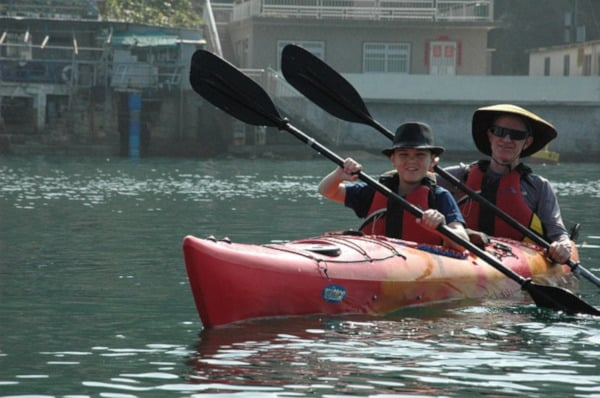 Best Tandem Kayak - two people in a kayak paddling in the sea