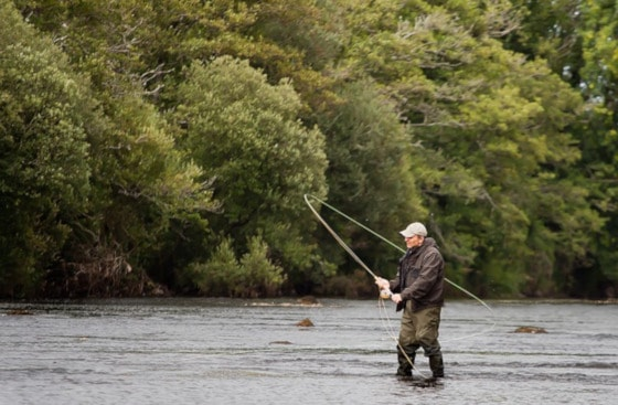 Best Baitcasting Reel   Man Casting In A River